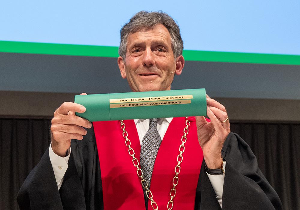 Prof Dr Bernhard Ehrenzeller, President of the University of St.Gallen (on the image), congratulates Dr Peter Tinschert virtually